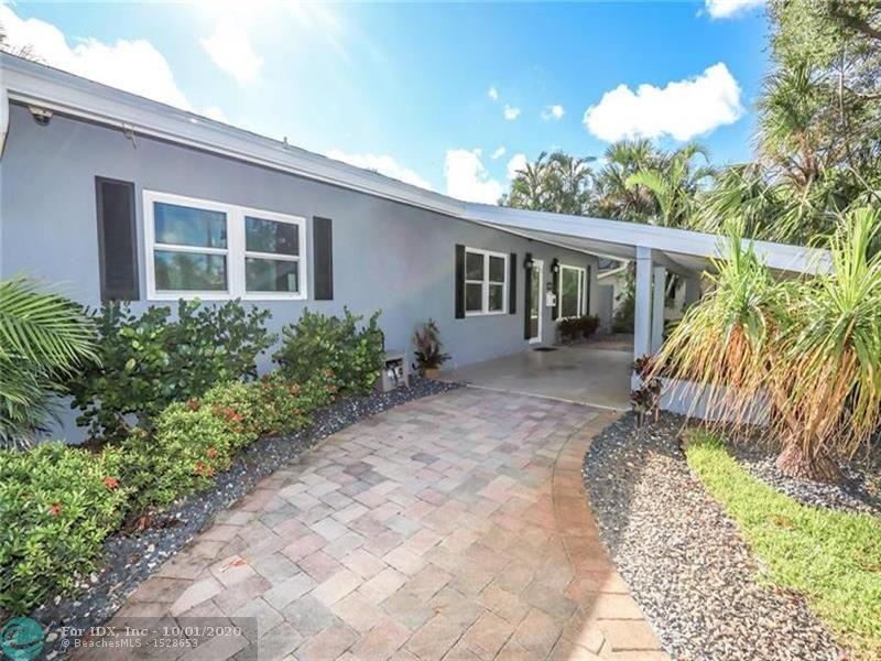Wilton Manors Westside Waterfront Gem! This 3/2, Mid-Century Renovated, Open Floor Plan.Tile Floors throughout, Newer Kitchen with Granite Countertops, Stainless Steel Appliances. Updated Bathrooms. Quiet Location, Long River Views From Yard or new Dock. Prof. Landscaped And Tropical, Low Volt Lighting.  Laundry, Circular Brick Paver Driveway, Carport, Newer Roof, New Impact Glass, Alarmed With Cameras, Updated Electric. Boat Lift, Fixed Bridges.