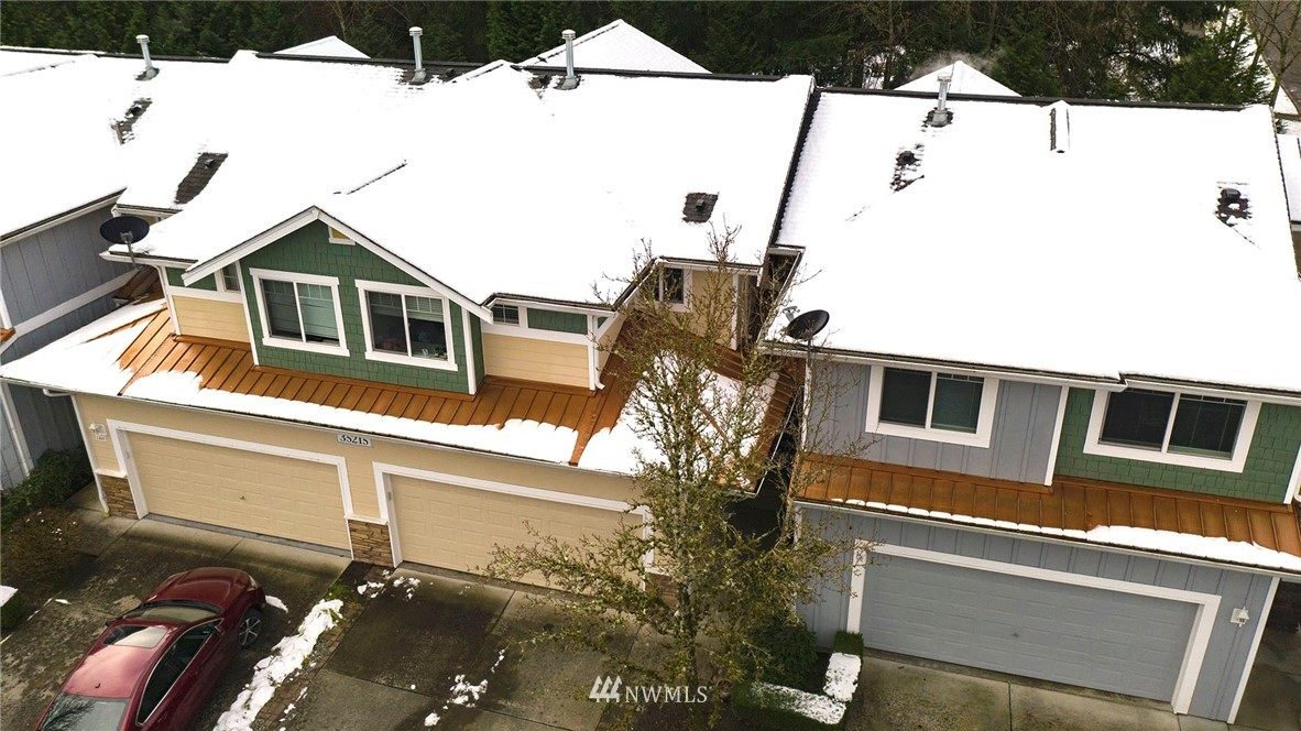Exquisitely remodeled 2 story Townhome at Aspen Village w/ front load 2-car garage on greenbelt with privacy. This turnkey home has hardwood floors on main & marble countertops in kitchen & baths. Kitchen is open to Great Room w/ custom built peninsula & includes SS appliances/gas stove/double oven. Vaulted ceilings in Great Room w/ gorgeous floor to ceiling natural marble tiled gas fireplace. Designated dining space & powder bath on main. Upstairs are 2 spacious bedrooms w/ ensuites. Primary has custom walk-in closet/soaking tub/shower/double sinks. Don't miss the bonus Loft upstairs! Upstairs laundry room! Smart+ motion lighting throughout. Perfect location in the heart of Snoqualmie Ridge. Walk to restaurants/shops/parks/trails & school!