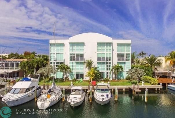 WELCOME HOME to contemporary living in the heart of Intracoastal waters and beaches. This gorgeous contemporary unit is a 2/2 with open floor plan, 18' vaulted ceilings, spiral staircase to the lofty master bedroom that is consumed with natural light. DEEP CANAL, DEEDED DOCK FOR A 30' BOAT. NO FIXED BRIDGES, OCEAN ACCESS, IMPACT WINDOWS, BALCONY, HIGH-END WOOD, AND PORCELAIN FLOORS, FABULOUS CABINETS, COUNTERTOPS, AND LIGHTING. Convenient to restaurants, beaches, airports, Port Everglades, and downtown. Most furnishings included. MOVE-IN READY.