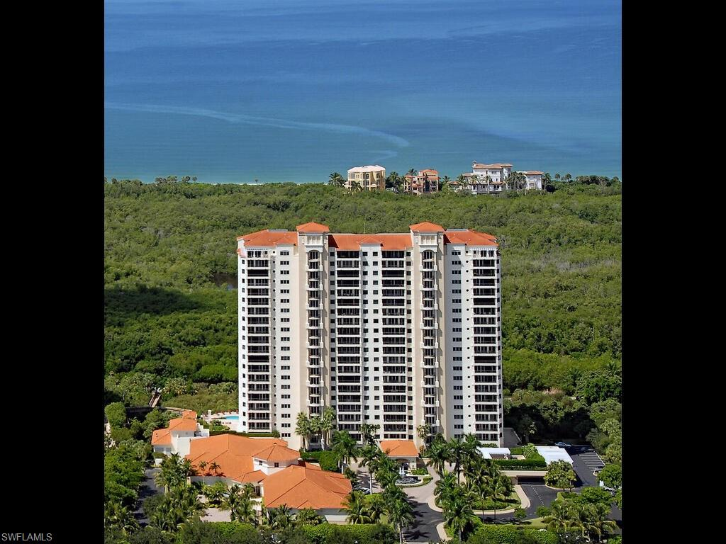 """Ideally positioned on the 5th floor, this light and airy 2,194 sq. ft., 2 bedrooms plus den/third bedroom floor plan provides clean lines and generously proportioned rooms offering expansive views of the Gulf of Mexico and Pelican Bay. Providing lots of space for visiting family and friends, both bedrooms are en-suite and the floor to ceiling sliders in the living room and den fill this expansive residence with light throughout the day. Enjoy the sounds of songbirds and gentle warm breezes from two large sunrise and sunset terraces. Enjoy nature while riding the tram to the beachside clubhouse with outdoor dining. The Marbella at Pelican Bay is truly a 5 Star Resort lifestyle.  Savor fine dining in four beautiful venues or room service.  Relax in the library, grand salon and outside terraces.  Amusement and entertainment await you in the social room, card room, or the arts and crafts room. Stay in shape at the fitness center, resort pool with lap lane and spa. Giving peace of mind and healing, The Cove, is a """"state of the art"""" 14 suite wing  for assisted care, will surely comfort you.  Our concierge and staff will arrange for all your desires and wishes."""