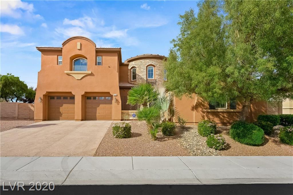 Stunning 3,854 square foot home w/ upgrades throughout. Enter through the charming courtyard to discover an impressive foyer & great room w/ cathedral ceilings, floor to ceiling windows, grand staircase & formal dining room. Entertain in the front & relax in the rear w/ a family room, fireplace, 2nd staircase, breakfast area & gourmet kitchen boasting granite, dble ovens, built-in fridge & butler's pantry. Also on the main level, a den & detached casita w/ en suite bath. Upstairs, 2 secondary beds share a full bathroom & a computer loft, study & rec room provide endless fun & function. Master features balcony, 2 walk-in closets, & spa inspired bath w/ dual vanities, garden tub & tile-surround shower. The huge private yard is a dessert oasis w/ an inground pool & spa w/ slide, waterfall & safety fence, plus lawn & 2 covered patios overlooking serene desert & mountain views. New AC units & water softener in 2020! In guard gated community w/ highly rated schools & convenient location.