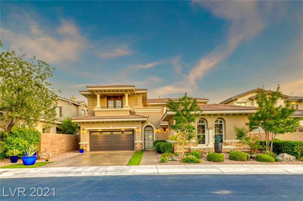 This is your chance to live in the highly desirable guard-gated community of MacDonald Highlands & DragonRidge Country Club! This stunning home is located on the 8th fairway w/ breathtaking views of the golf course & mountains. Featuring a front gated courtyard w/ fountain & fireplace, a detached casita w/ full bath, den/office at the entry, formal dining room overlooking the front courtyard, great room w/ built-ins & fireplace w/ stacked stone, kitchen w/ granite countertops, stainless steel appliances, double ovens, gas range, guest bedroom & full bath downstairs, upstairs features the primary bedroom w/ sitting room & balcony, remodeled primary bath has walk-in shower w/ rain shower head, free-standing tub & walk-in closet w/ custom built-ins, two guest bedrooms w/ jack-n-jill bathroom, large loft & balcony w/ Strip views! Enjoy your coffee under the covered patio that features custom solar shades & retractable awnings while taking in the stunning views from your private backyard!