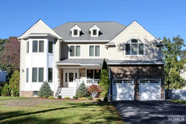 Welcome to Glen Rock! Custom Built 2007 Colonial 5 bedrooms & 3 and a half baths. Features include: 10 ft. ceilings. Spacious LR., Formal Dining Room, eat in Kitchen with Central Island w/sliding glass door to deck and patio, Lg. Family room with gas fireplace, library, 2 car oversized garage and a powder room. The second floor has an exquisite primary suite w/2 wic and full bath w/sep. stall shower, jacuzzi, 3 very spacious Bedrooms, full bath and Laundry. The basement is full and finished with an exercise room and Bedroom and a full bath, lots of storage. Amenities include hardwood floors on the first and second floors, elegant molding, whole house generator, skylights, vaulted ceiling, water filtration, osmosis & hardwire internet. Close to NYC bus and train. Close to school and houses of