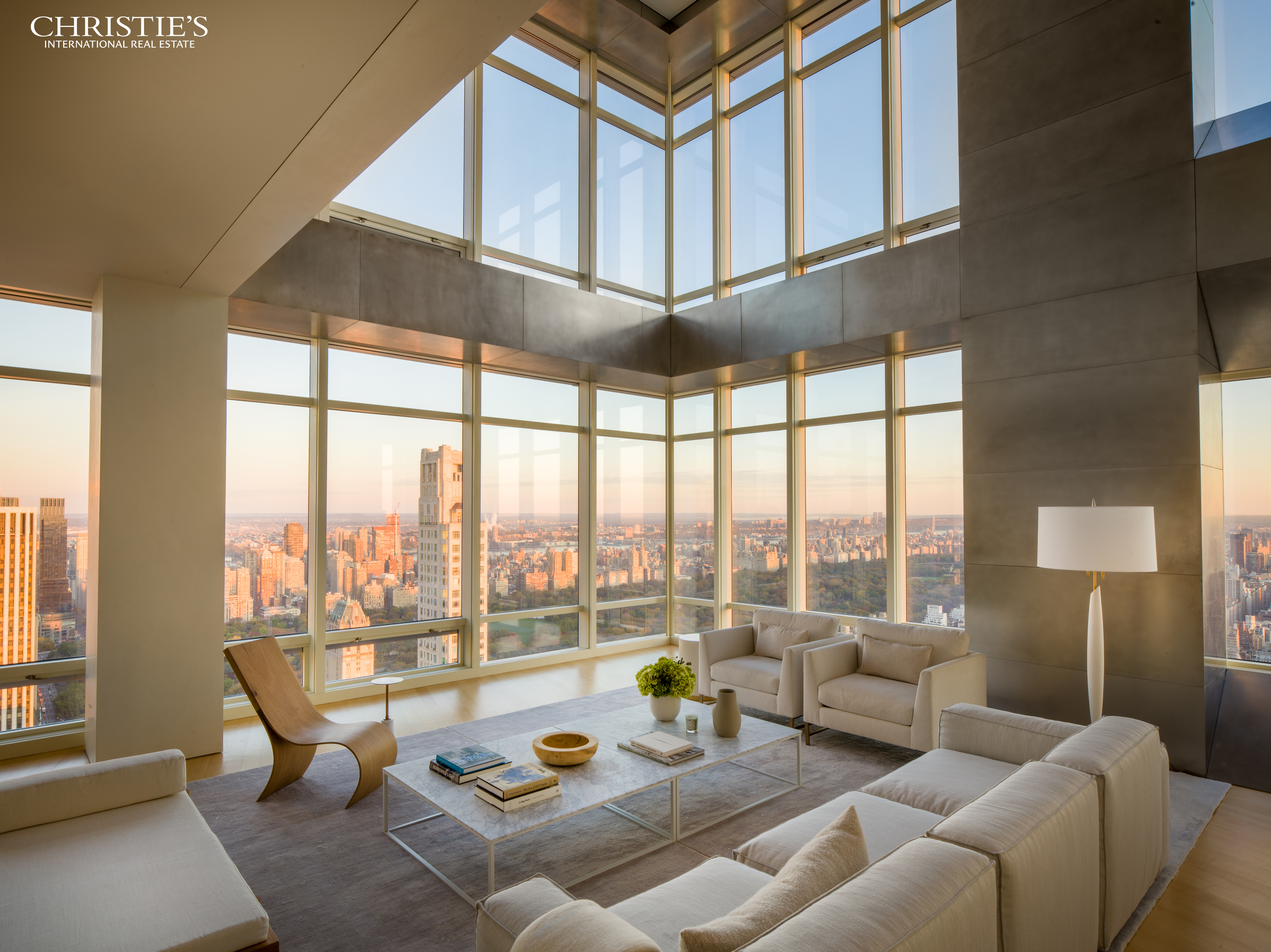Best PH PPSF Citywide.  Lowest PH Price with Central Park Views.  Best PH Value Citywide.Breathtaking helicopter views of the Manhattan skyline, Central Park, the East and Hudson Rivers and beyond define this sky-high penthouse duplex. With 9,000 square feet, five bedrooms, and six-and-a-half bathrooms by architectural legend Charles Gwathmey, this palatial home features an awe-inspiring, 24-foot double-height ceiling in the living room, a chef's eat-in-kitchen with state-of-the-art stainless steel appliances, separate floors for entertaining and living, and a nearly 2,000-square-foot master suite with dual closets and separate bathrooms. Double home offices, a media room, two living rooms, and separate staff quarters and storage complete the property. Soaring over 700 feet above midtown, PH51/52W offers views for miles, taking in landmarks and scenery rare in the current market and at this price per square foot. Through 400 linear feet of 12-foot-high windows showcasing northern, western, and southern exposures, open vistas span from the East River to the Hudson and from the Freedom Tower to the George Washington Bridge. One Beacon Court is Midtown Manhattan's most established business address and premier luxury condominium residence, reached securely off 58th Street via private drive court. Amenities include a fitness center complete with barre exercise room and treatment room, a resident lounge and business center, a children's playroom, and catering kitchen space. Also known as the iconic Bloomberg Tower and adorned at its spire with three floors of wraparound red, white, and blue lighting, the building was developed by Vornado Realty Trust and houses at its base both Bloomberg L.P. as well as Hutong, the New York City outpost of the Hong Kong and London-acclaimed northern Chinese, high-end restaurant. Its neighborhood includes Central Park, Billionaire's Row, Fifth Avenue and Madison Avenue shopping districts, Midtown business centers, and some of the finest an