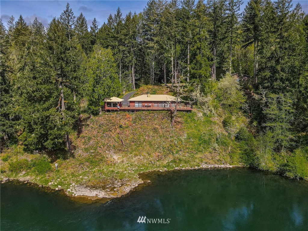 River paradise. You can't build this close to the river anymore. Feel the stress wash away. Very well maintained & well appointed home. Quality touches - standing seam metal roof, new trex deck & metal railing, granite counters, rich wood interior.