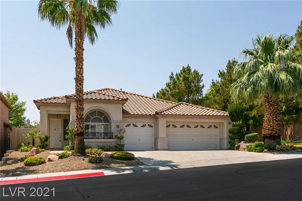 """Hard to find 1 story home with a 3 car garage. This home is located in gated """"Cantabria"""" a Summerlin Community.  This home has a  little neighborhood park to the side of it to relax in the shade or take a pet out. White cabinets, granite counite counters, undermount lighting. The kitchen opens to the family room which has a two sided fireplace. To keep you cool during summer this home has all tile throughout.  3 bedrooms, one was used as a den with glass doors, this was the sellers art studio. There a formal dining room or front room that can be have multiple uses.  Check out the location of this home, close to shoppping, restuarants and the freeway."""