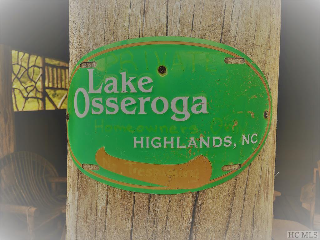 Lake Osseroga is a small gated lakefront community with its own boathouse with lake access and storage for canoes. The community is conveniently located between Cullasaja Club and Wildcat Cliffs. This lot is pond front and looks back up to the waterfall.