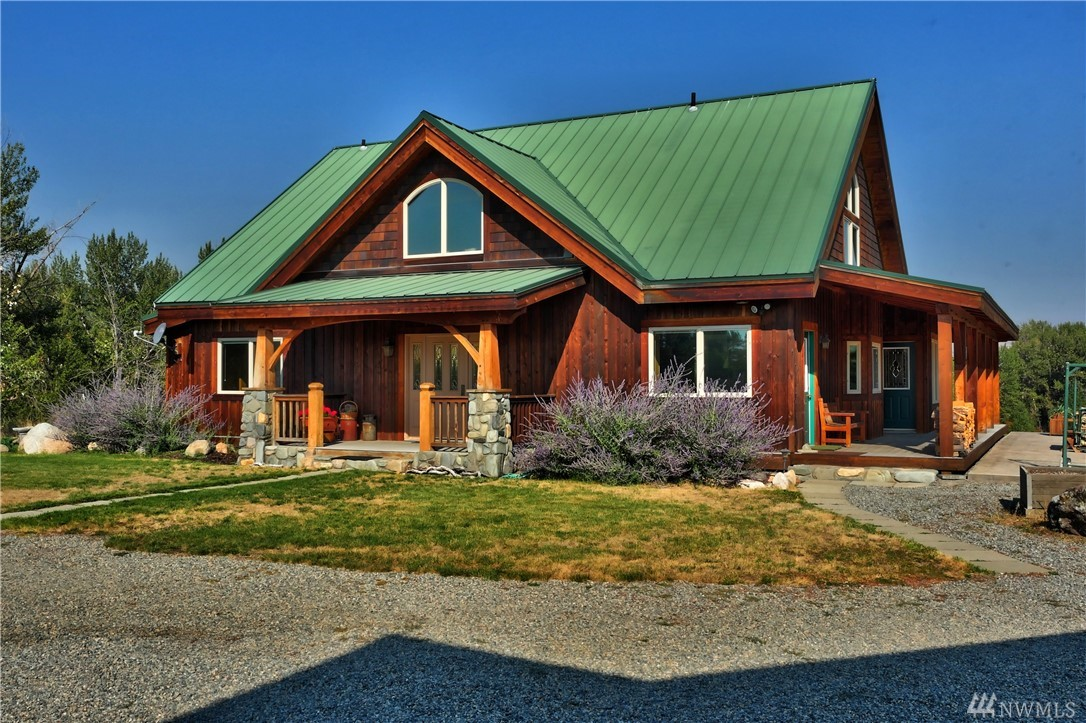 WINTHROP: Methow Riverfront and custom Timber-frame home on nearly 10 acres plus additional 6 acres shared with 1,400 feet riverfront, sandy shoreline and one of the valleys best fishing holes. Beautifully designed and constructed, dramatic river & mountain views.  Grand living room/dining/kitchen w/ river views, 3 BDRM, 3 BA, study/home office, covered decks/ porches & patios.  Includes detached garage w/ 5 parking spaces, extra-large shop 30X60.  A statement of quality and luxury.