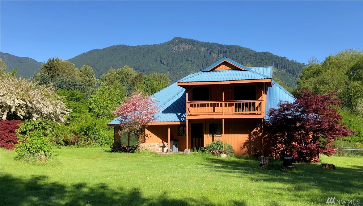 Custom designed home with unique architectural details.  Just 4 miles west of Packwood, it is surrounded by 11 +/- acres of woods, pasture, and native landscaping.  Area around house is fenced.  Driveway is gated.  Master bedroom and great room open to large deck with territorial views of the Cascade foothills.  New floors in kitchen and bathrooms, new counter tops in kitchen and both baths will be installed prior to closing.  Slate entry.  Perfect for year round or vacation living.