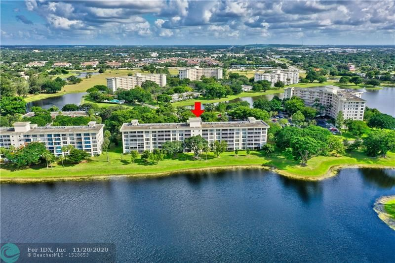 Best wide water views in Palm Aire!  2 bed 2 bath unit with a white kitchen and hurricane impact slider.  Unit is in pristine condition.   Great amenities including heated pool, children's play area, tennis, exercise facility, walking paths, and a Publix inside the complex.  Unit can be sold furnished or unfurnished.