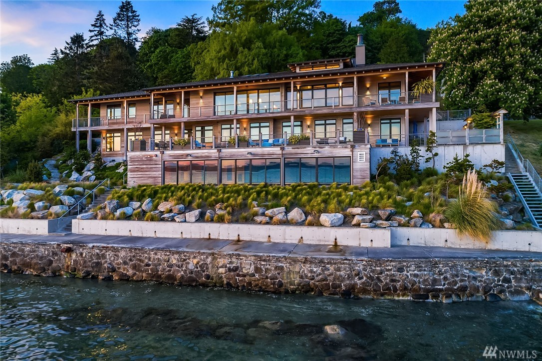 Rare masterpiece! Designed by Tom Lawrence, built by Schultz Miller, this stunning NW Contemporary waterfront offers 150+/- ft of beachfront & unobstructed views. Featured are: High ceilings, abundant natural light, chef's kitchen, master suite w/fireplace & m/bath w/ Japanese soaking tub, indoor pool, A/C, gym, office, library, motorized shades, generator; wine room; lush grounds; moorage and guest house. This residence is for your discriminating Buyers seeking a tranquil oasis one with nature!