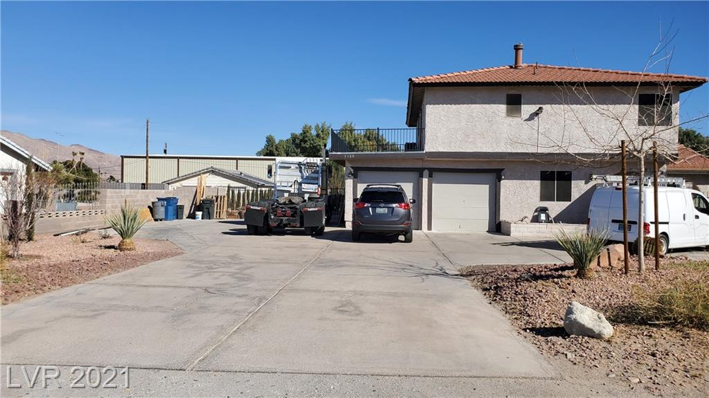 BEAUTIIFUL 2-STORY HOME WITH MOUNTAIN/STRIP VIEWS ZONED ON A NON HOA HORSE PERMITTED LOT WITH 20,000 SQ FT. 1/2 ACRE, RV PARKING. GENTLY FLOWING LANDSCAPED YARD W/A 700 SQ. FT. COVERED PATIO, GORGEOUS POOL. LRG LIVING AREA W/STUNNING WOODBURNING FIREPLACE, FORMAL DINING. KITCHEN INCLUDES EATING/DINING AREA, BREAKFAST BAR & ISLAND. THIS HOME FEATURES PLENTY OF UPGRADES. ALMOST $30K INTO BATHROOM UPGRADES. AND MANY MORE UPGRADES THROUGHT THE WHOLE PROPERTY.  A VERY UNIQUE HOME. MUST SEE!