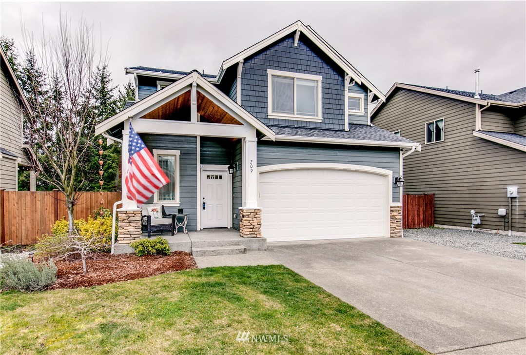 Welcome to this beautiful 4 bedroom home located in the desirable town of Orting. This home is turn key ready and has it all!  The open layout downstairs is perfect for entertaining, the stunning kitchen features custom cabinets and a large bar with plenty of seating. Upstairs you will find the lovely master suite with walk-in closet, 5 piece bathroom, huge soaking tub and beautiful view of the backyard! The other 3 bedrooms are great size and all have walk in closets!  Step outback to the massive backyard filled with fruit trees, beautiful garden, huge shed and a large patio with ceiling fans perfect for your summer BBQs! This home has fresh paint throughout, AC, tons of storage and has been impeccably maintained.