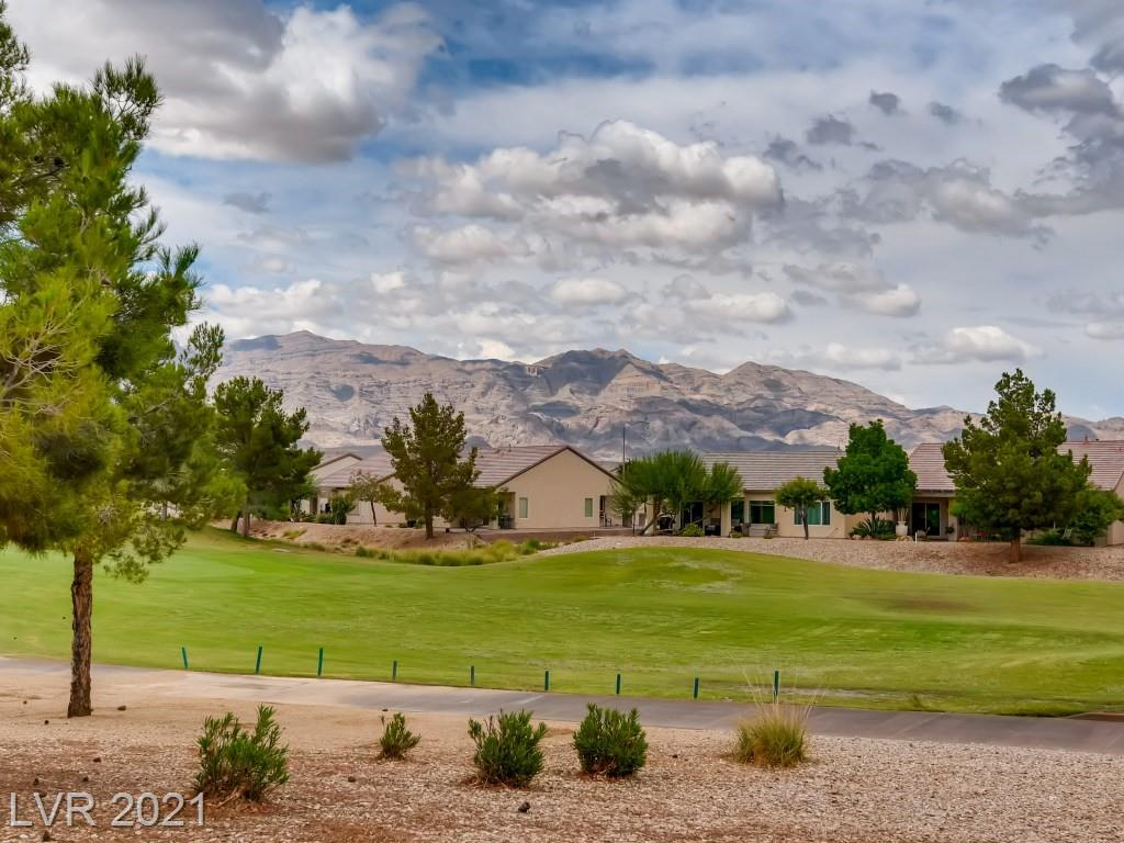 Fully furnished Helena model on the signature 17th hole in Aliante Golf Course, with incredible golf and mountain view.  Perfect for a second home or vacation home, ready for move-in, just bring your toothbrush.  Oversize front courtyard perfect for enjoying your morning coffee, island kitchen with lots of cabinets with pull-outs, granite countertop, eat-in nook, tile flooring, fully covered patio great for entertaining just off the 17th tee box, must-see oversize primary bedroom, bathroom includes a double sink, walk-in closet.  The newer part of the community and close to Aliante Casino.