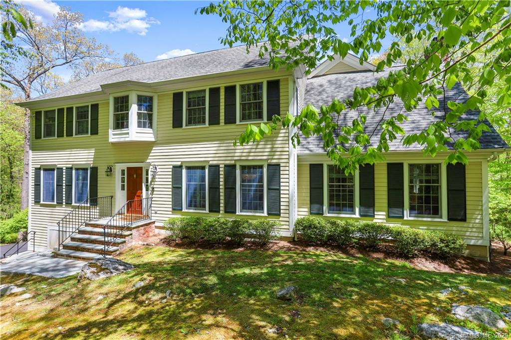 An awesome escape in tranquil location, yet just minutes to the Merritt! Fantastic space, lovely property and private setting invite you in to this wonderful & versatile home. Lots of living options offering room for everyone include Living Room & Dining Room both with French doors; granite & stainless Eat-In Kitchen with butcher block center island and separate breakfast area & door to deck opens to fabulous Family Room with brick fireplace and French doors to spacious Playroom/Office with doors to deck. Powder Room and Laundry complete the main level. Upstairs boasts a private Master Bedroom with marble floored Bath and walk-in closet plus separate sitting area with back staircase. Three additional well proportioned Bedrooms, loft-style central Sitting Room and Full Hall Bath on 2nd floor. Great lower level with Rec Room open to large additional room, perfect for work outs or whatever you can imagine, with access to yard. Lovely wrap-around deck offers pleasing views of the sweeping yard. A terrific home in the Wildwood Association!