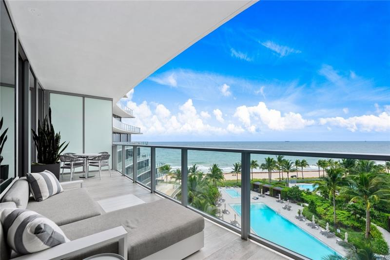 The best 3 bedroom North Tower value - move in & enjoy this Fall! Perfectly capture the essence of Auberge with sophisticated & warm coastal modern living interior design! The through floorplan offers incredible Atlantic, intracoastal & city views from expansive balconies.Residence itself is so functional, private entry foyer to the fabulous open living & family rooms that surround the Chef's kitchen with 2 areas for informal dining.The living room opens to ocean/pool facing balcony & offers mesmerizing views.Master suite also overlooks ocean/pool, custom closets & spa-style bath, also accessing the South-East facing balcony. Perfectly private separation is offered 2 bedroom suites on the other wing (also access a large balcony), both capture great views.Enjoy world-class Auberge amenities