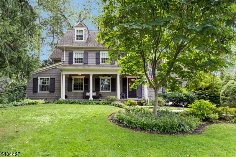 Curb appeal abounds in this elegant & inviting Colonial in the heart of Wychwood. (4 BR's & 41/2 B)  Starting from the inviting Front Porch to beautiful detailing in the formal Living Room & Dining Room, and a Chef's Kitchen that opens to a Family Room with a Fireplace, luxurious Baths, gleaming Wood Floors, separate Office, Mud Room, plus an Office Alcove. No detail has been overlooked. Abundant storage & extras include a Recreation Room, Media Room & Wine Cellar. A Gem not to be missed!