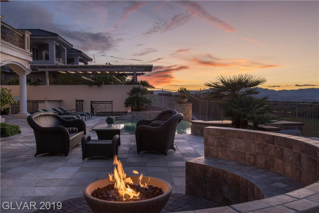 This home has it all - from second to none quality through out - to an outstanding and functional floor plan - to some of the best views of the city in all of the Vegas valley. All of the rooms are well proportioned, there is a huge kitchen with top-of-the-line Wolf, Sub-Zero and Miele appliances, a large family room as well as formal living and dining, 2 master suites (one up and one down), movie theater, huge wine cellar, elevator and an office
