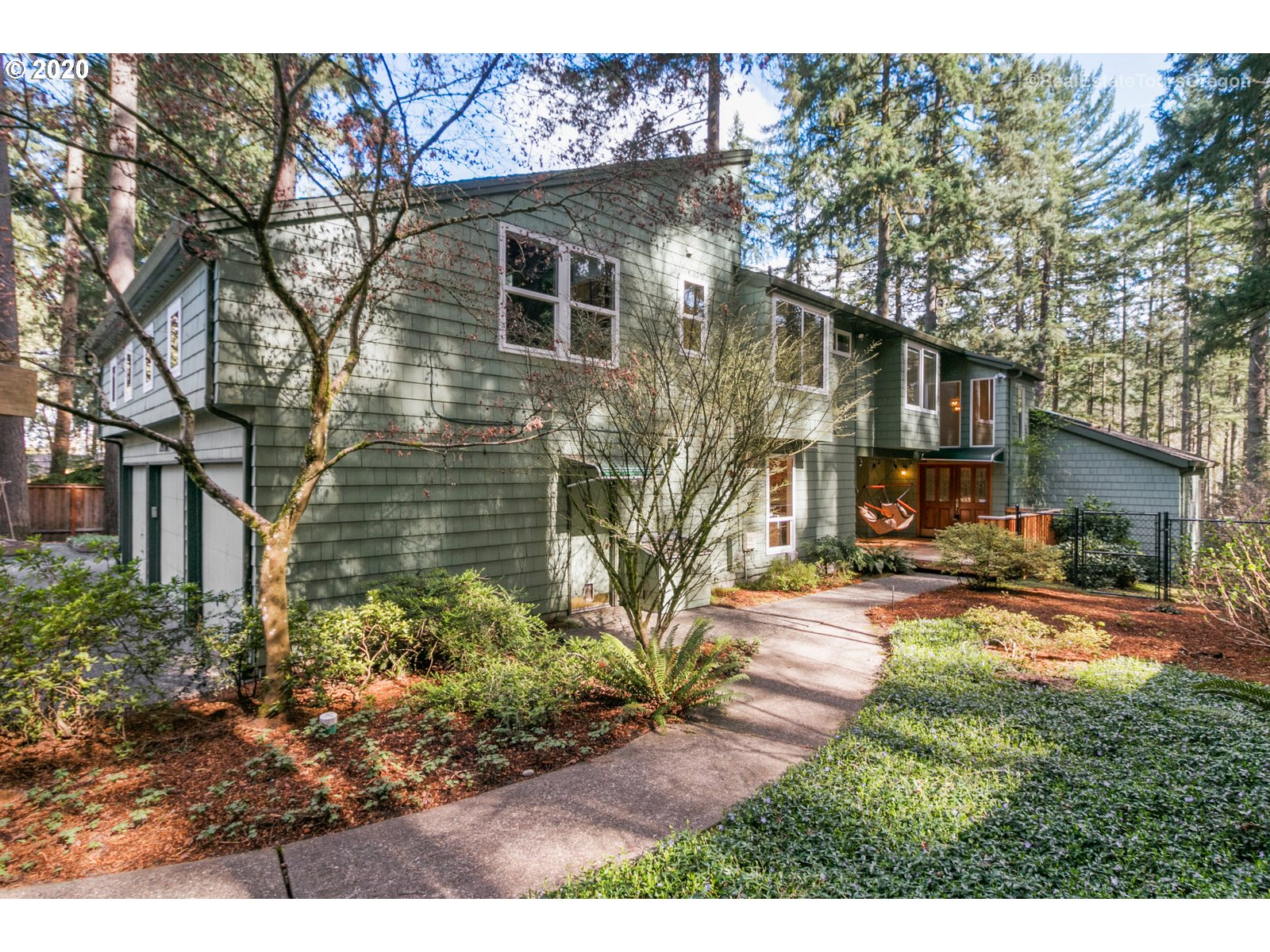 Spacious Custom Remodel 4262 sq ft 4 bedrm/4bth home on .44 acres w/high ceilings, open beams, gorgeous hardwood  floors, 2 fireplaces and lots of light. Has Loft/ Den w/ Blt-Ins & Flex space for Studio w/Ext entrance. Adjacent to Hyland Forest Park trails and nature area on a quiet street, close  to Nike/Intel/EZ access to dwntn Portland. Lg living spaces w/ 2nd master suite on main, gourmet kitchen, deck w/ view,Auto-xfer generator and 3-car garage plus add'l parking. A Must See!