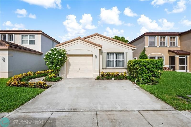 Beautiful 3 bed 2 bath single family home conveniently located on Hillsboro Blvd in a quiet gated community near shopping centers, restaurants, and schools. Front and center view of the lake from the kitchen, master bedroom, and screened in backyard patio! Brand new water heater!