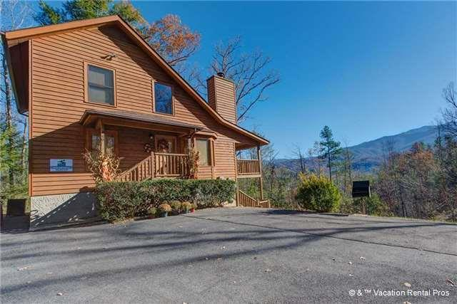 Very private 4 BD/3 BA  2,300+ sq. ft. cabin that's nestled in the woods with a lovely Smoky Mountain view. It's also within walking distance to picturesque Mills Park, Gatlinburg Community Center, Anna Porter Public Library, Rocky Top Sports World & the Gatlinburg Trolly stop. Currently on a well-established rental program with over $68k in 2020 rent.  Sitting on 0.68 acre with ample level parking and two spacious decks to enjoy the seasonal mountain views of the Smokies (which could be improved with some judicious tree trimming). Located along a city street supplied with public utilities, street cleaning and garbage pick up. Only minutes to the area's most well-known attractions, including the beautiful Greenbrier section of the Great Smoky Mountain National Park, action packed downtown Gatlinburg and much more. On the main floor you have a large open concept great room with vaulted ceilings, a towering mountain stone fireplace adjacent to the eat in kitchen featuring wrap around windows. The master bedroom on the main level has an on-suite bath complete with a whirlpool tub. The lower level has a spacious family/recreation room as well as a proper theatre room and another bedroom suite. Upstairs boasts an open loft, two more bedrooms and a full bath. Lots of space with this cabin, both inside & out. A great, well-located and private cabin - come see it today before it's too late. Drone Photography used.