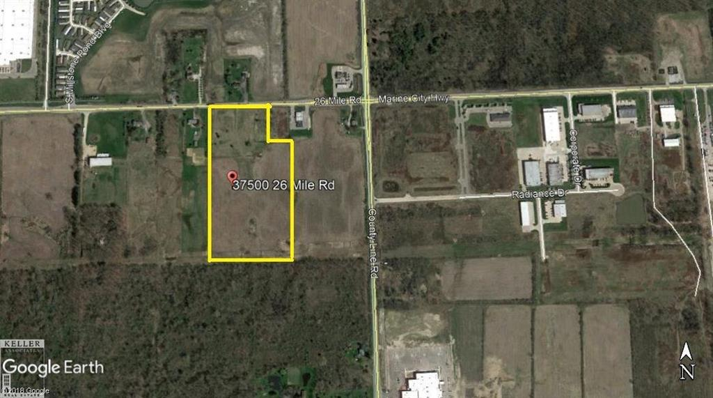 Large industrial parcel with 527' frontage on 26 Mile Rd. City water, Natural Gas and Electric at street. Located close to I-94 Interchange, Meijer & the new Beaumont Hospital (new facility under construction).