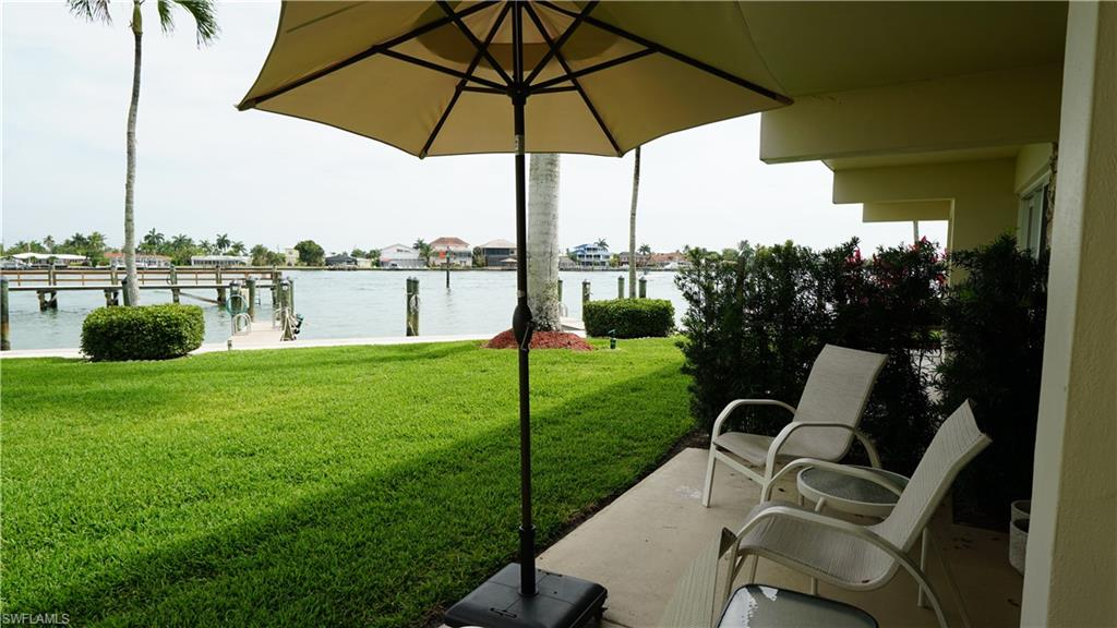 Rarely available, Marco River Waterfront First Floor Condo, located in the Quaint Village of Olde Marco. The Views are amazing with Dolphins & Manatees playing just steps away from your patio. The Condo has been beautifully updated The Tropical Grounds are Meticulously Maintained and the Condo Association offers a huge Fishing Pier and Community Room right on the Marco River with views of the Gulf of Mexico. Boat Docks are available to lease annually or monthly with a convenient on-site Boat Ramp to launch your boat. The Location and Views makes this Condo a Tropical Paradise to enjoy for years to come.