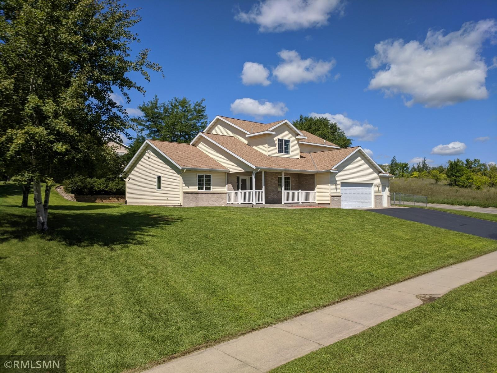 Move-in Ready! This home is located in a beautiful tucked away neighborhood outside St. Cloud, with easy access to Highway 10. The home has spectacular curb appeal with its large corner lot, in-ground sprinkler system, and covered front porch! It has a large 3 stall attached garage, with mud room/laundry area coming into the home through the garage. When entering through the front, your eyes will be immediately drawn to the fireplace, with large vaulted ceiling. The main floor offers an option for a home office or bedroom just off the entry with a bathroom for your guests, a main floor owners suite w/WIC and private bathroom, a large kitchen with granite countertops, brand-new stainless-steel appliances, and a beautifully laid out dining room with tons of natural light. The 2nd floor features 2 bedrooms with large WICs, an additional 3rd bedroom, and a large full bathroom. The home is blocks from beautiful ski and mountain bike trails, Munsinger gardens, and many other park options!