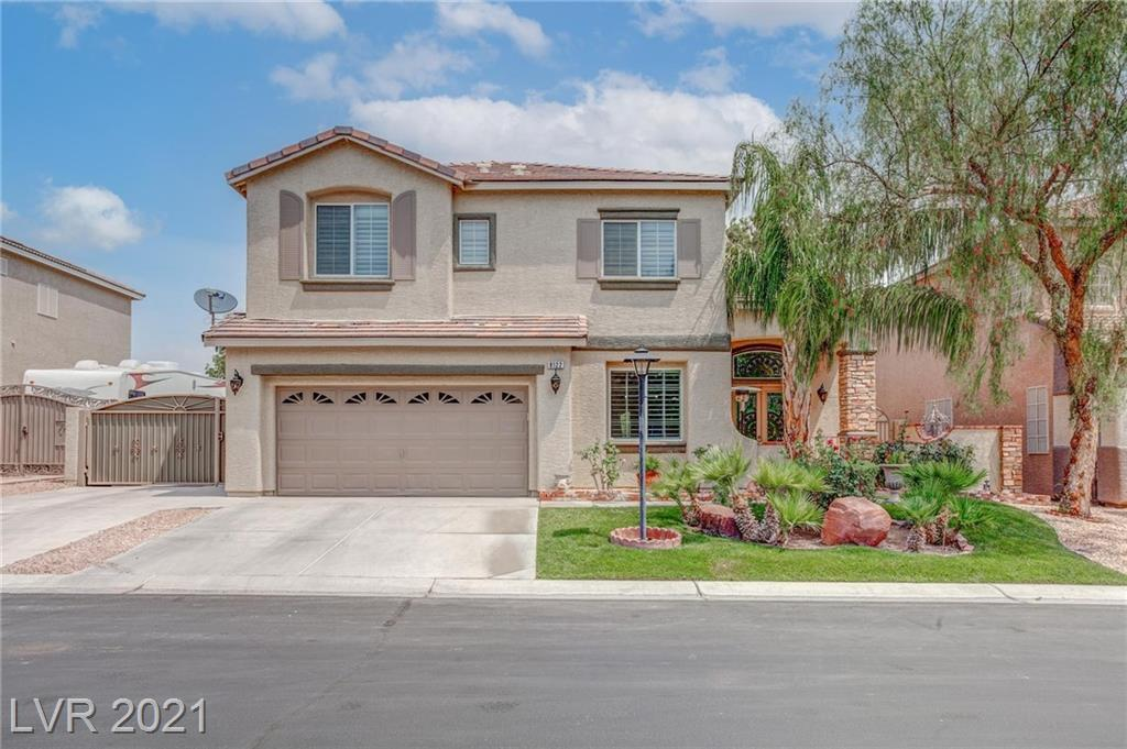 Immaculate condition, newly painted and upgraded 3bdr+ den, 3bth 2-story home in a gated subdivision.  25-30-yard walk to a private park.  Backyard borders Floyd Lamb State Park and Tule Springs - mountain views forever! Bedroom, Den, or Office & Bath downstairs!  RV/Boat parking with full hookup: electric and sewer. 2-car Garage with Workshop!  Newly refinished and premium upgraded Kitchen Cabinets, spacious, dazzling, Quartz-top Center Island, almost new high-end SS LG Appliances with Double Built-in ovens, Walk-in Pantry! 9' ceilings with 18' formal living room.  Great Room off the kitchen wired for Surround Sound. Ceiling fans in all rooms! Plantation Shutters on all windows! Spacious Primary Bedroom with 9' ceilings and large walk-in closet! Gorgeous Pool with a REAL Rock Waterfall and separate above-ground Spa! Outdoor ambient lights for every palm tree! Two nice Sheds in the Entertainer's Backyard, Covered Patio w/Fan.  Super quiet location in the NW!