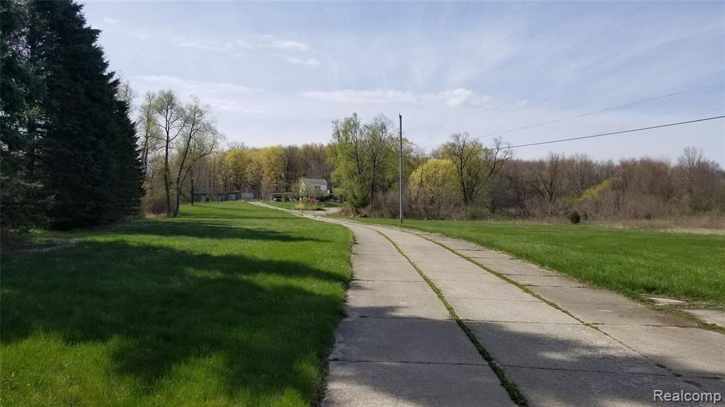 Beautiful 13 acre estate in the city of Novi.  This parcel has it all.  A tranquil approximate 1 acre spring fed pond sits in front of your home along with a huge yard that stretches to Eleven Mile.  Behind your home is a woodland filled with wildlife.  The home is very bright with an open floor plan that features 4 bedrooms with 3 full baths.  The master bedroom is on the first floor with its own bath along with a second bedroom.  There are two other large bedrooms on the upper level with their own private balconies.  The home has many updates including a new kitchen, electrical system, paint, newer roof, furnaces and windows.  There is more room to grow with this property if you wanted to add on or build another home for your family.  This property also feature detached garages, storage building, and an old horse barn.  This property is a shown by appointment only.  Buyers must have a pre-approval or proof of fund for a showing.  All information is approximate and should be verified.