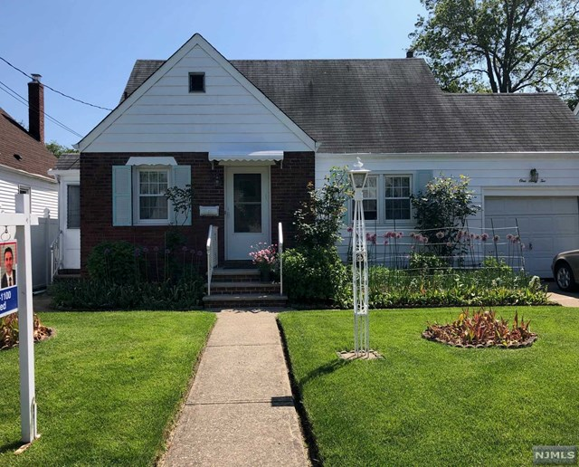 Terrific location for this well kept, 3-4 BR Cape, 3 bath (1 full 2 half) w/finished bsmt w/bathrm, Summer kitchen & walkout back door! Gorgeous back yard to enjoy the upcoming Spring & Summer days! Attractive curb appeal w/brick front, & beautiful plantings to greet you! 1st flr has living rm, eat-in kitchen w/dining area, Full bathrm & 2 BRs (1 currently used as formal dining rm). 2nd flr could be a Master suite w/its large BR, bonus area (could be 4th BR or home office) half bathrm & large closet. Large finished bsmt is like its own studio apartment w/a walkout door! And finally the beautiful backyard w/patio is a great place to have gatherings & outdoor fun! Theres even a sun room too! All this & prime location, great curb appeal, & walking distance to everything! Including Maywoods famous downtown shopping, NYC bus, schools, parks & more! Make this your new home!