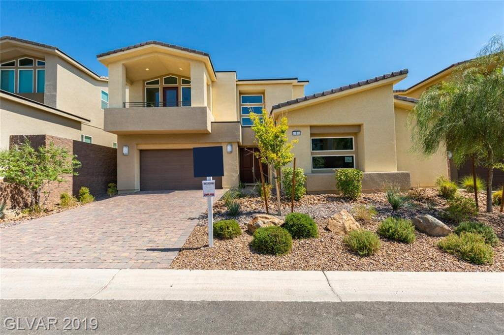 William Lyon Homes New Construction with MASTER DOWN! Beautiful, move-in ready home, located in gorgeous Lake Las Vegas with 3 car garage, designer finishes, wood-like tile through the entire first floor and plush carpet in bedrooms plus loft with a deck.