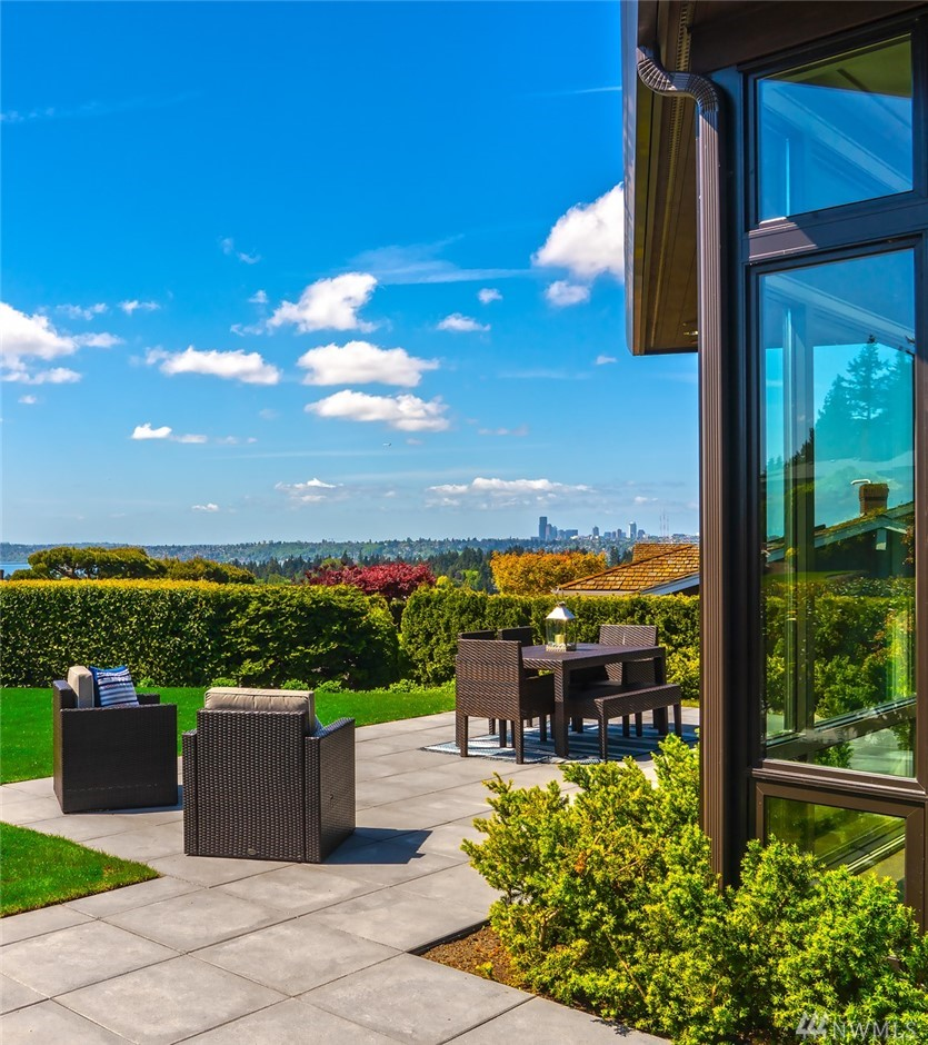 The iconic Seattle skyline shines in this Modern in Mercia. Just completed in 2017, the open floor plan draws in breathtaking west facing views of Lake Washington, the city & the Olympic mountains. Designed with entertaining in mind, this home offers over 7,500 square feet of casual and formal entertaining spaces. Luxurious main floor master suite, rooftop deck, media area & plenty of space for extended stay guests. A floor plan offering flexibility and ease. Start the new year in your new home.