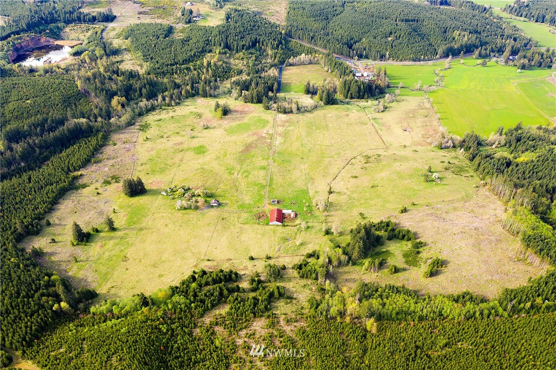 One of two adjacent 80-acre parcels, own one or both and enjoy total privacy and security that only significant acreage of sun drenched valley can provide. The two parcels are fully fenced and at road's end, passing through the gated drive, you're greeted by Stearns Creek babbling under the engineered bridge. Gentle rolling pasture surrounded by acres of timber farm; perfect for a private air strip. This 80-acre parcel already includes a classic farm house that could be delightfully remodeled. Or, build your custom dream home overlooking the pasture on one of many pristine building sites with territorial vistas. Seller financing available. Explore the opportunity and make this your private compound.