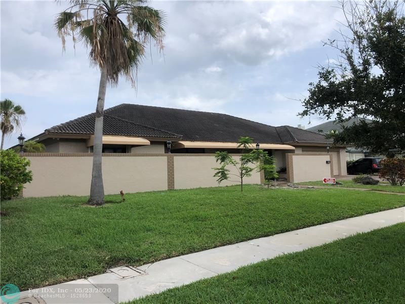 Beautiful East exposure with view of trees not buildings. Split floor plan with master suite 2 wet bars, formal dining and living room. Oversized 2 car garage