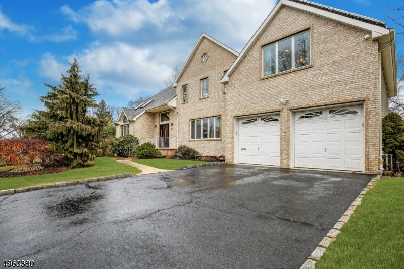 Welcome to this lovely Colonial in the highly sought after Hillcrest section! Custom-built home greets you with a large foyer leading to a bright, open concept kitchen & family room w fireplace. Tons of living space! Sliders off the kitchen w a center island lead to patio & recently refinished inground heated pool & hot tub, perfect for gatherings or a swim! First floor  features a powder room & laundry. Second floor has 4 generously sized bedrooms and an office. The master bedroom has an ensuite bath w stall shower and jetted tub, as well as a walk-in closet. A tremendous fully finished basemt rec room complete w the third full bath, great for media watching or entertaining. Other features: 2 zone CAC&Heat, recessed lighting, Central Vac, OWNED Solar panels. Lea to provide special showing instructions.