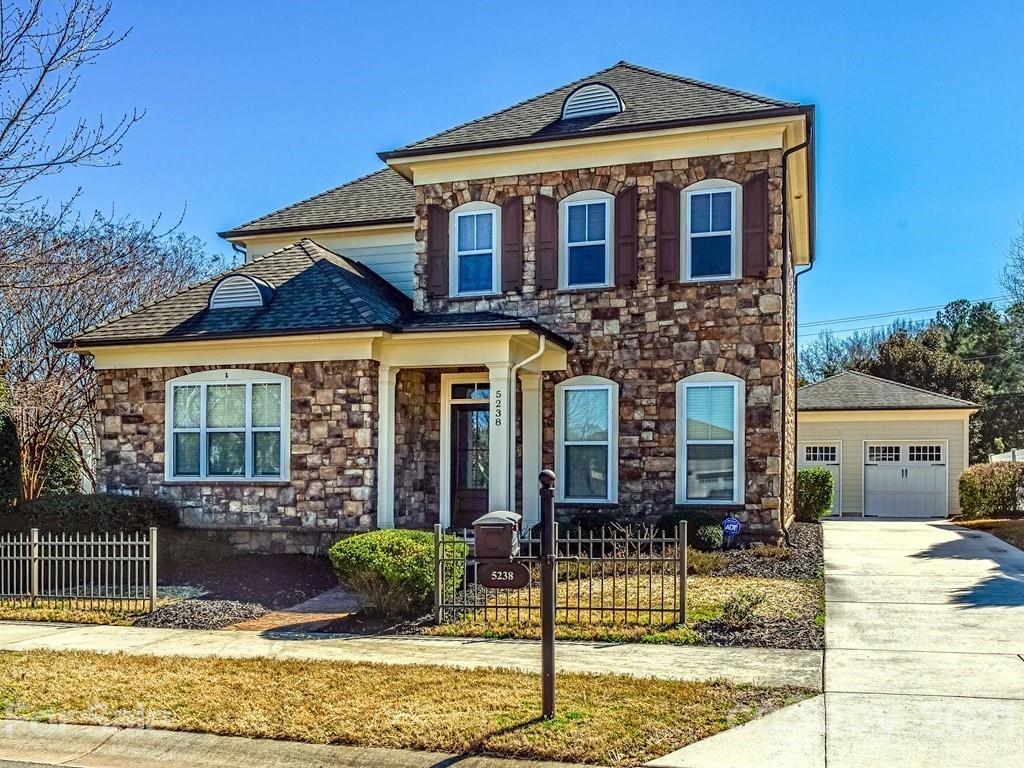 Elegant Georgian home with stone exterior in Gated Community! Minutes to highway, Northlake Mall and Downtown Charlotte! Beautiful pre-finished wood floors, crown molding, coffered ceilings, this home has it all!  Gourmet kitchen with granite countertops, SS appliances, large pantry & island!  Living room has coffered ceiling, beautiful wood mantel with granite surround, custom built-in cabinets on either side & double french doors leading to patio. Formal dining room has beefy crown molding & wainscoting. Main floor master has crown mldg, mbathroom has upgraded cabinet, dual sinks, oversized shower & soaking tub. Upstairs are two additional bedrooms, hall bathroom and large loft! The backyard has paver patio and newly sodded grass. Irrigation system. New paint and carpet throughout!  This was a Model Home. Tankless Hot Water Heater - 2020