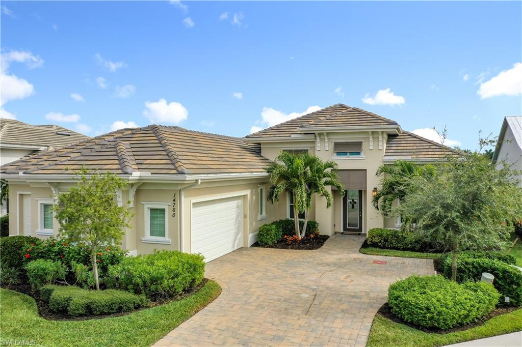 Enjoy panoramic lake views. This nicely appointed Stock built home has been meticulous maintained and nicely appointed. Upgrades include  impact glass throughout, plantation shutters, summer kitchen, extended lanai, brick pavers lanai & driveway, 3 car garage, full home generator, instant hot water system, aqua link pool system, 500 gallon in ground  gas tank for pool, spa and cooktop, ,stainless steel appliances, upgraded flooring throughout,  volume ceilings, quartz counter tops, speakers in all rooms,  custom painting and more. Come and explore Naples Reserve. A close-to-everything location in Naples, Florida, this luxury real estate community has it all. Seller is a licensed realtor (owner)