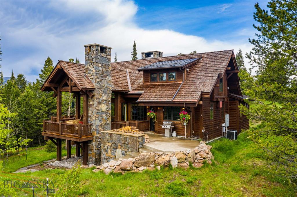 "Nestled on a ridge line with spectacular views of the Spanish Peaks and Lone Peak, this custom-built mountain-style home sits on 1.4 acres at the end of a private cul-de-sac. Designed with the ""Not So Big House"" model in mind, the home has no wasted space, maximizes storage and puts the square footage in the rooms in which a home-owner spends the most time. The gourmet kitchen is outfitted with top-quality appliances. Head out to the deck and enjoy your dinner next to the fireplace as you take in views of Lone Peak, as well as the wildlife walking on the game trail behind the house. Winter nights can be spent cozying up to the two-story Chief Joseph dry stack wood burning fireplace. If you look closely, you can spot numerous fossils in the stone. Located barely a mile from SPMC, you will be close to the action but far enough away to have peace and quiet when needed."