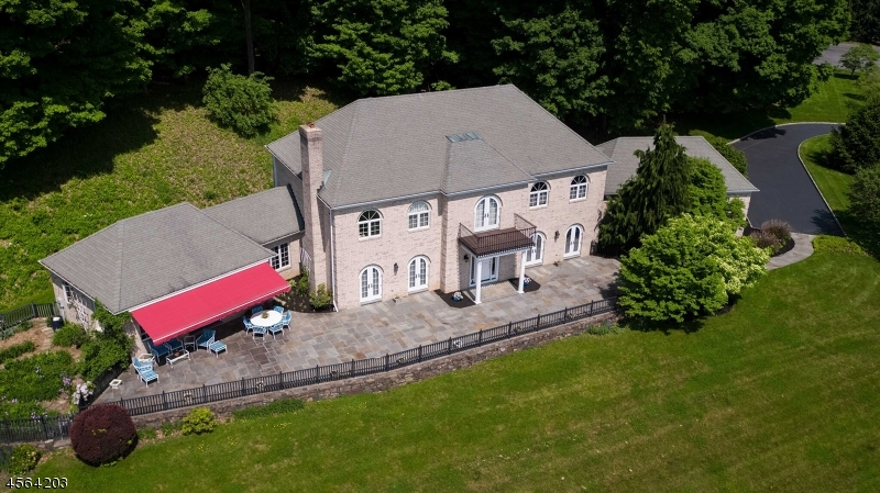 2020 assessed value. $863,100. 2020 estimated annual taxes: $19,497.43 Drop In Yearly Tax of $ 5,800 	  PREMIER ALL-BRICK CUSTOM COLONIAL ON 4+ ACRES  IN TEWSBURY                                                                                                                           Mesmerizing country and mountain views define an all-brick 1994 custom Colonial offering 4,325 square feet of luxurious living space. Sited on 4.73 cul de sac acres, an expansive bluestone terrace across the facade overlooks spectacular distant panoramas. An elegant open floor plan of four bedrooms and two-and-one-half baths is enhanced by an attached three car, oversized garage. The scenic acreage surrounding this home offers some of the best views in Hunterdon County in a convenient location near Interstate 78 in Tewksbury. A built-in generator offers additional peace of mind in this exceptionally well maintained residence.   Highlights of the graceful residence include crown moldings, arched French doors with pocket screen doors, Italian tile and oak hardwood floors, a marble-clad fireplace, ceiling fans, recessed lights, high ceilings and custom built-ins. Natural light spills into gathering spaces from dramatically oversized windows and glass doors, many of which connect to the entertainment-friendly terrace.  Introducing this home is a dramatic two-story front to back entrance foyer with a sweeping staircase and Italian tile floors. This grand entrance is flanked by the elegant living room opening to the terrace and family room. A series of arched French doors in these formal spaces reinforce the home's strong indoor-outdoor connection. The privately-situated study could alternately be used as a fifth bedroom, as this home provides a five bedroom capacity septic system.  An inviting gourmet kitchen presents a tiered center island featuring a built-in desk area, dark granite counters, tile floors, custom white cabinetry with leaded glass inserts, upper-end appliances and French-style doors opening to the spacious bluestone terrace. The sun-splashed breakfast room overlooks the terrace and amazing views. The sunny fireside family room anchored by a marble clad wood-burning fireplace also accesses the bluestone terrace. Completing the main floor is an oversized laundry/mud room with door access to the rear of the home.  Upstairs, a sophisticated master suite entered through a set of French doors has private redwood balcony, walk-in closet and spa-like master bath offering a marble-clad platform tub, double sink vanity, separate shower and marble tile flooring. There are three additional, spacious bedrooms on this level and another full bath. An abundance of storage space is located in the unfinished basement and oversized three-car garage.    The original owners have taken great pride in ownership of this premier Colonial. It is ideally located on a quiet cul de sac street in Tewksbury Township. Mechanical systems include multiple zones of (oil)  hot water baseboard heating, central air conditioning, a built-in generator, private septic and well water.   This residence is ideally located on a quiet cul de sac road in Tewksbury Township. Tewksbury Township in Hunterdon County includes the quaint and historic villages of Pottersville, Oldwick and Mountainville.  A charming mixture of Victorian, Federal, New England and Georgian-style homes can be seen from winding country roads. Unique shops, superb dining and easy access to Interstate 78, 287 as well as Routes 206 and 24 are available for commuting.  Newark Liberty Airport is within 35 minutes away and two commuter airports are also in close proximity.