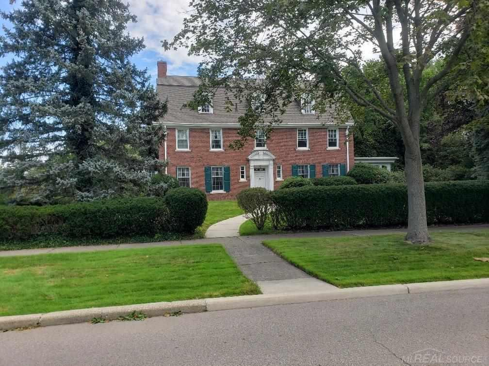 1922 Brick Colonial in prestigious Wind Mill Pointe Subdivision on corner lot. Lot is 120 x 225.  Home is over 5,000 sq feet. 4 bedrooms and 2 1/2 baths plus a 3rd story featuring 2 additional bedrooms, full bath and unfinished attic (49 x 15)  Carriage House with 3 car garage and 2nd level living quarters.  Classic colonial features include formal dinning room, hugh living room and attached sun room.  Home is in disrepair but is ready to be brought back to its former glory.  Immediate occupancy.