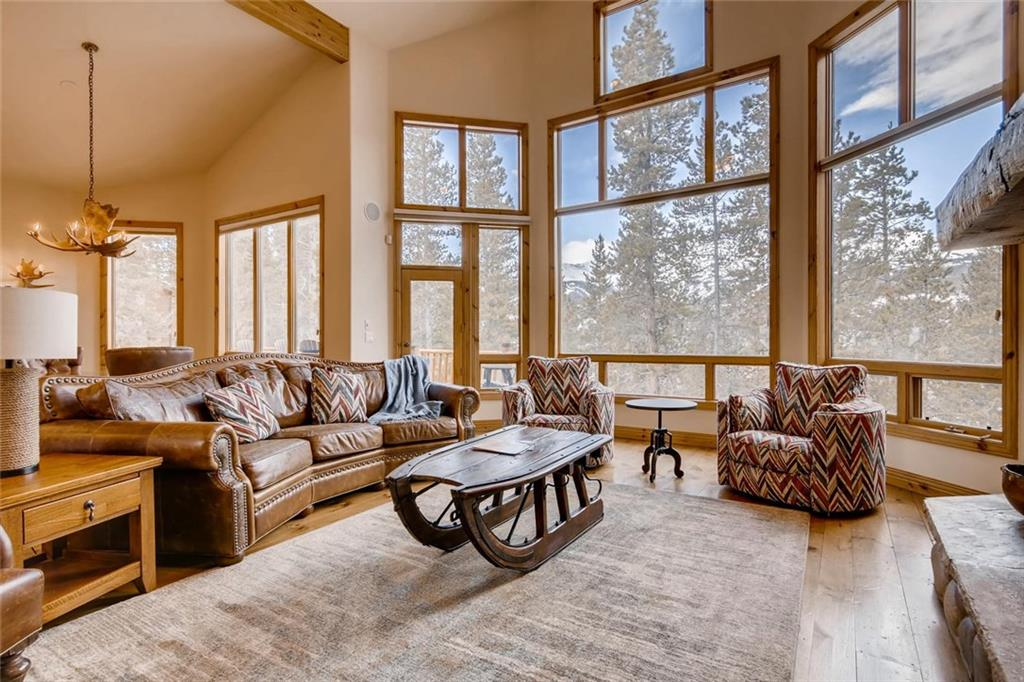 This quality lodge in the exclusive Highlands at Breckenridge neighborhood has a grand living space with floor-to-ceiling windows for incredible natural light & inspiring views of Breckenridge. You will see craftsmanship throughout & the refined furnishings are an added bonus! With en suite bathrooms in 5 bedrooms, a main-floor master, 2 living areas with fireplaces, radiant heating, a private hot tub & on a pristine treed acre; this investment will make a lasting impression when entertaining!