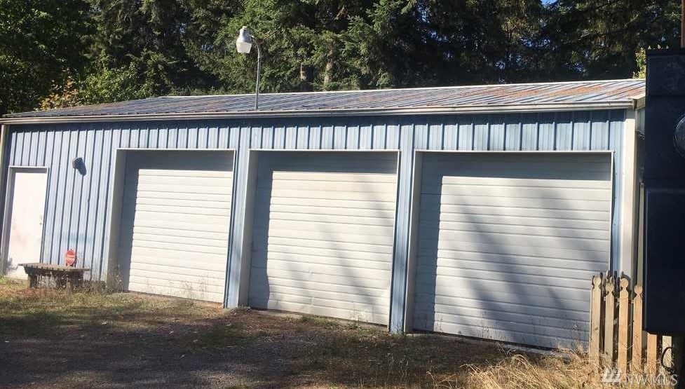 Very unique lot with over an acre of mature trees, secluded bird sanctuary and useful small storage sheds.  The value is in the land with a three bay shop w/workshop attached Plus 4 other sound outbuildings.  Great opportunity to build your dream home nestled in the trees with all the infrastructure already in place!