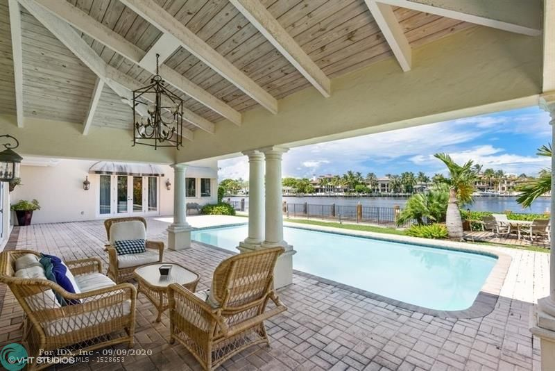 Stunning, unobstructed views as you enter this home across the bay looking north to Bahia Mar Yacht Basin. Private location on Isla Bahia Drive. CBS construction of the second floor renovation in 2001 featuring two Master Suites located on first and second floor. Spacious open floor plan with 100 feet of dockage. Neighborhood offers high elevation in land, wide turning basins, marina, beach club and security with ocean access for your yacht just minutes away. A pleasure to show!