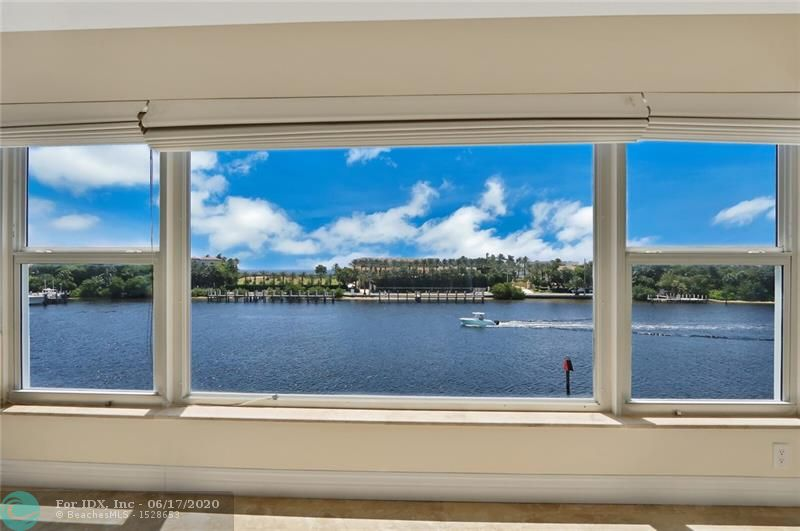 Beautiful top floor unit with direct intracoastal and ocean views from this totally remodeled 2 bedroom, 2 bathroom condo!  Nestled in the marina area of Lighthouse Point and home to awesome views of the inlet, Hillsboro Lighthouse and daily intracoastal boat parade, this condo is a winner! Unit 8D features a beautifully renovated kitchen with 42' custom cabinets, light granite counter and stainless steel appliances, both bathroom are updated as well as all the windows on the east side of the condo are impact rated.  Enjoy coastal living in this all ages community that has a pool with community room, Tiki hut for grillin and chillin', and a private boat dock that does have slips available for rent now!  Pick up trucks allowed!  Land lease included in the maintenance fee. Easy to see!