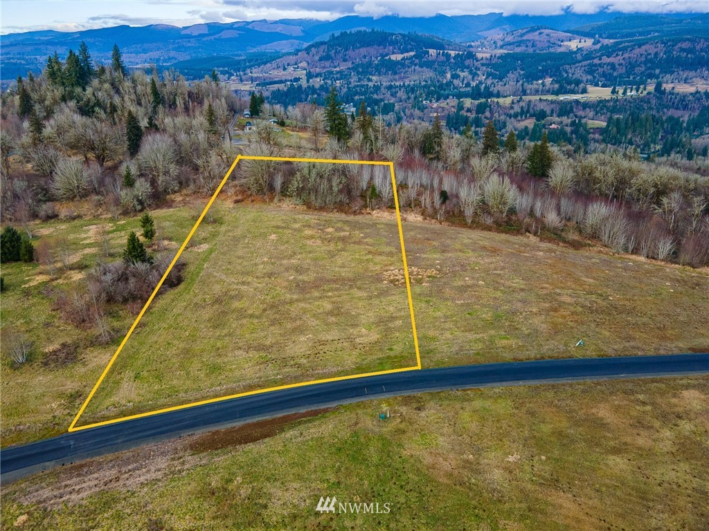 """5.1-acre lot with great territorial views of the Cascade foothills and a partial lake view.  New paved dead-end road and modest CCR's to protect your investment.  Power is at the front of the lot; well and septic will be needed.  Great location for full-time residence or for your """"get away"""" retreat.  Lake Mayfield is popular for skiing and recreational, and the Cowlitz River is known for great fishing.  White Pass Ski area is only an hour away and Portland or Seattle are less than 2-hours away.  Multiple lots to choose from with various acreage and most with lake or territorial views."""