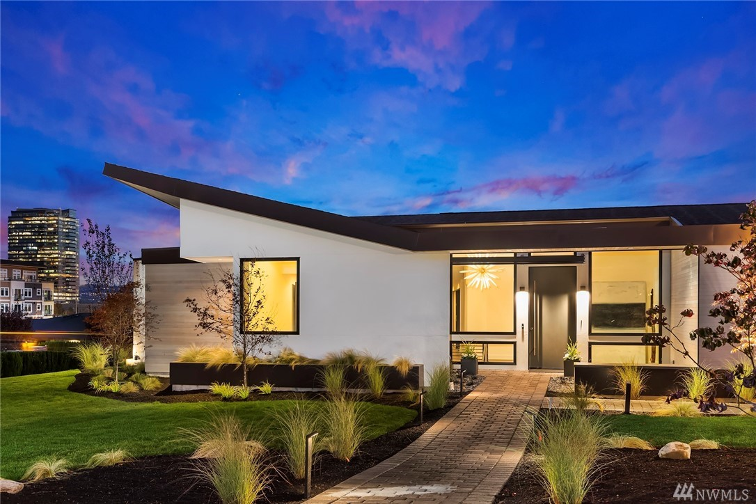 Modern Inspiration in Vuecrest. Stunning city skyline views create the perfect back drop at this airy architectural masterpiece by LUXE Properties. Walls of glass and an open floor plan designed for today's lifestyle. Enjoy casual evenings in the great room as the La Cantina doors open to outdoor entertaining. Relaxing master suite & additional bedrooms on the main. Spacious lower level w/ entertaining areas & 2 additional bedrooms. Walk to coffee, shopping & more from the heart of West Bellevue