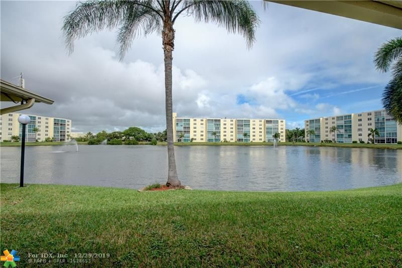 Excellent opportunity to own condo with prime east-facing lake view with fountains*Relaxing on the patio feels like you are directly on the water*Desirable 2nd floor and convenient to elevator*Spacious unit is ready for your updates although carpet is less than a year old, dishwasher and refrigerator are less than 2 yrs old*Two very large bedrooms, with tons of closet space*Easy access to the beach, shops, the new Dania Pointe, highways and FLL.  Extremely well-priced, see it today!!