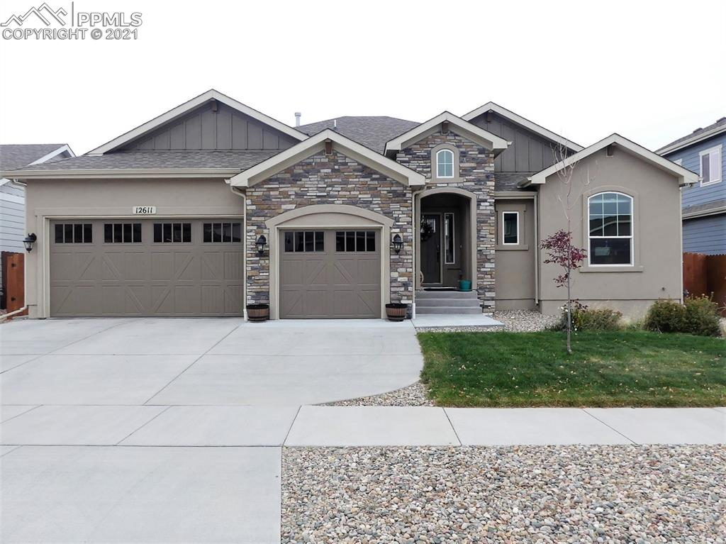 """Gorgeous ranch home located within the Meridian Ranch community which backs to open space and is walking distance to a beautifully maintained park. This 5 bed, 4 bath, 3 car garage is loaded with high tech features such as a server room, nest smart home, an ecobee thermostat, rachio sprinklers, a yale keypad, security cameras, and sensors! Enjoy the open floor plan on the main floor which boasts a gourmet kitchen, dining room, laundry room, and living room with a gas fireplace. The master bedroom with a master suite is located on the main level and comes with a walk in closet, and jetted tub to soak in at the end of a long day. There are two bedrooms that are adjoined with a """"Jack and Jill"""" bathroom on the main, along with another bedroom which is currently being used as an office. In the basement you will find a huge family room complete with a wet bar, mini fridge, a huge bedroom with a walk in closet and bathroom, along with a Winchester safe in the storage room. Not only do you get to call this place your home but you get to enjoy all that the community has to offer which includes a golf course, 42,000 sq ft recreation center, indoor and outdoor pools, dining, shopping, walking trails, and more. What are you waiting for?"""