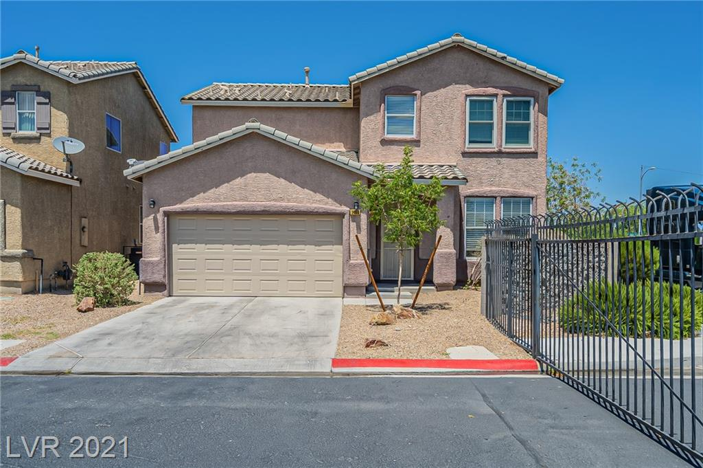This Las Vegas two-story corner home offers granite countertops, and a two-car garage.